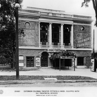 Exterior of The Colonial Theatre before it closed with signs and posters for The Road to Yesterday.