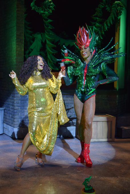 Bryonha and Taurean are toasting in costume on the set of Little Shop of Horrors.